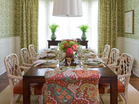 Red pattrened fabric on neutral geometric rug, Jeannie Balsam interior design dining room