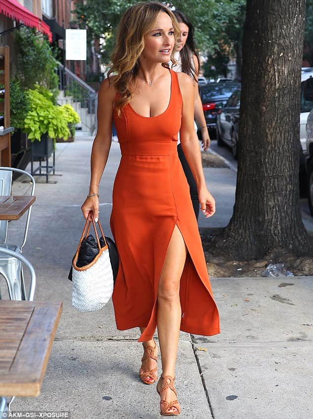 Designer rugs in orange are very popular and Italian-born American chef, writer and television personality, Giada De Laurentiis walks to lunch this month in New York wearing an orange maxi dress with a slit up one side.