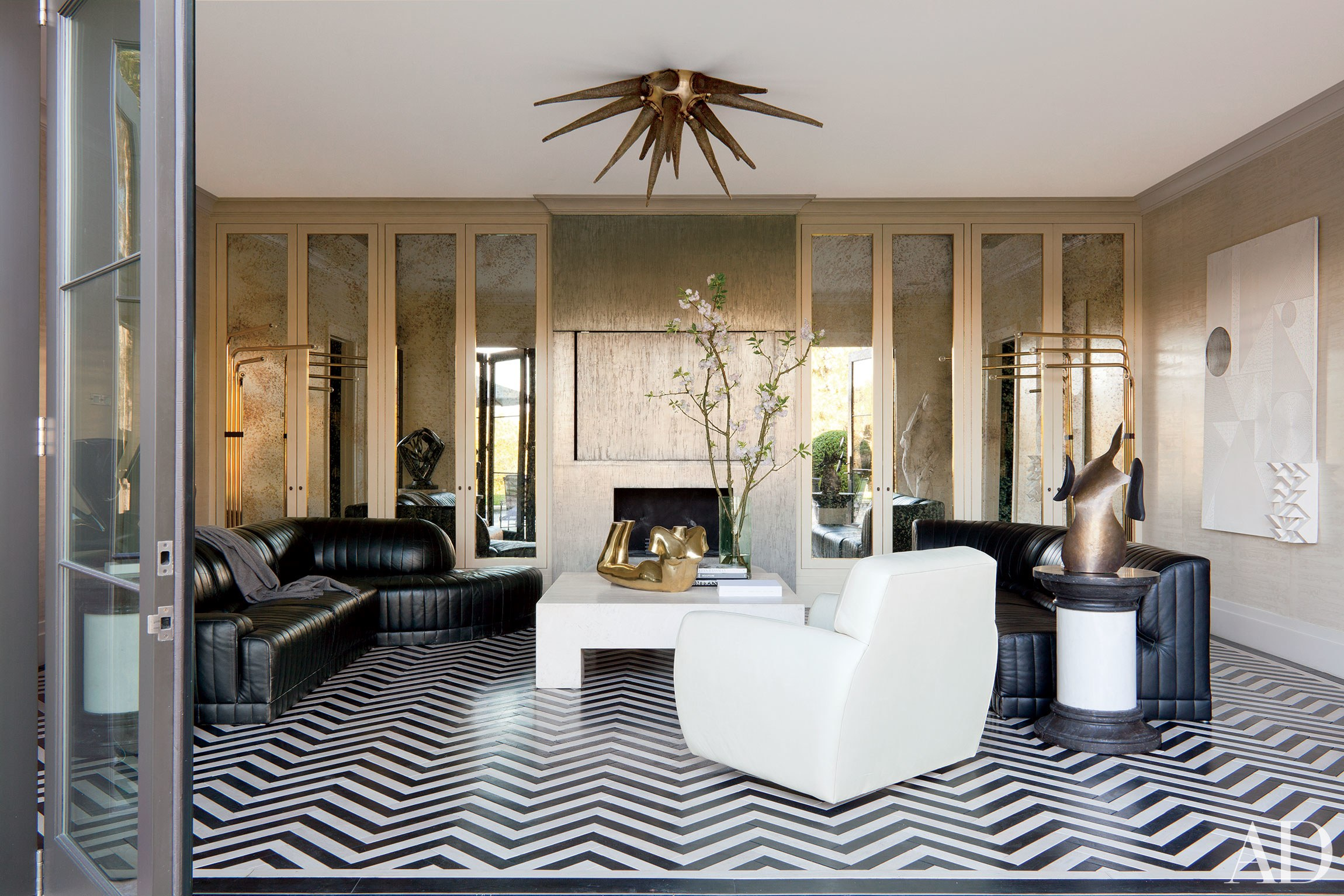 Wearstler selected a black and white Art Deco marble floor in this pool pavilion to offset the clean looking furniture and wall treatment.  Image courtesy Roger Davies.