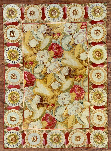 Red, brown, gold and white antique needlepoint rug