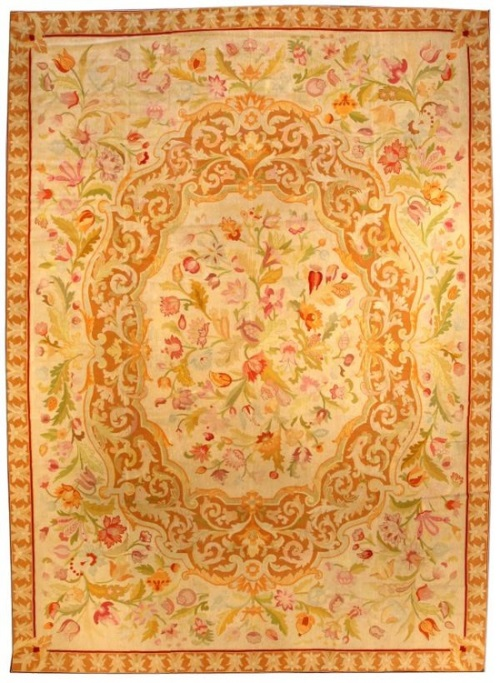 gold, green and red antique needlepoint rug