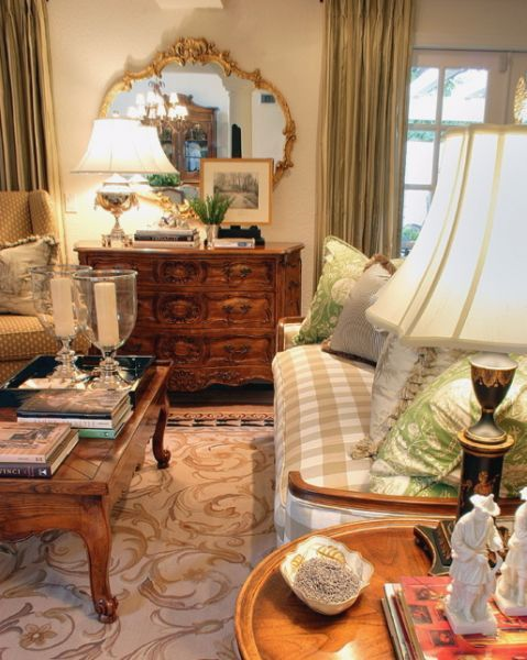 beige and navy Savonnerie rug in living room with beige gingham sofa