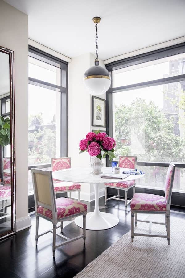 grey-rug-contemporary-rug-dining-room-pink-chairs-Nick-Olsen-Domino