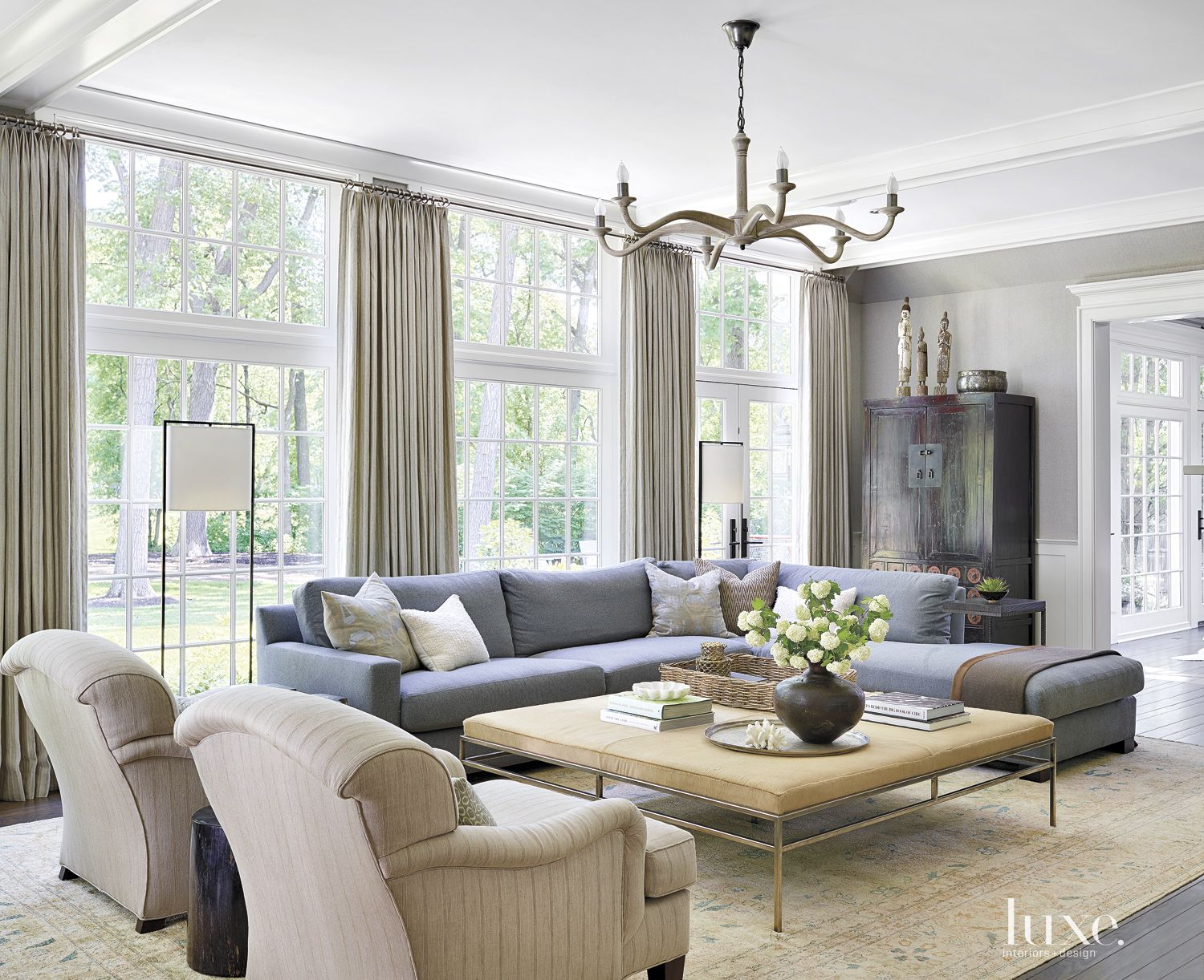A Winnetka contemporary home uses an Oushak rug to tie in the room's many calming hues.