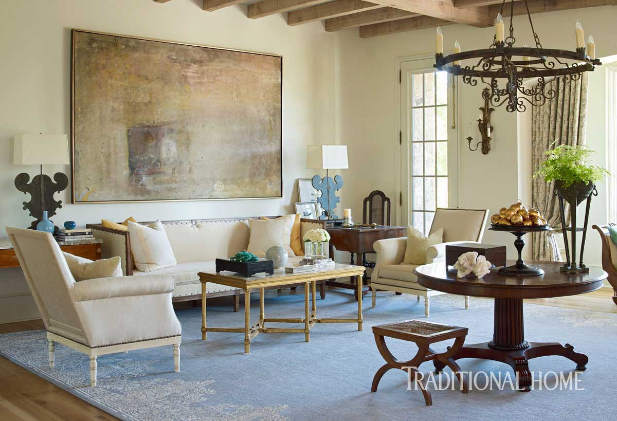 For a family of eleven, Phillip Sides helped architecturally build and design this 15,000 square foot home that rests on 30 acres with a private lake. In the family room he selected a lavender-blue wool and silk contemporary rug with a Moroccan-inspired ivory border.