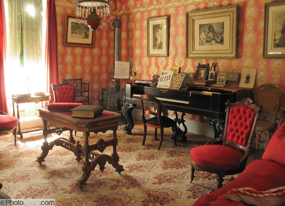 His Victorian Era living room features a Bessarabian rug with red, neutrals and cream.