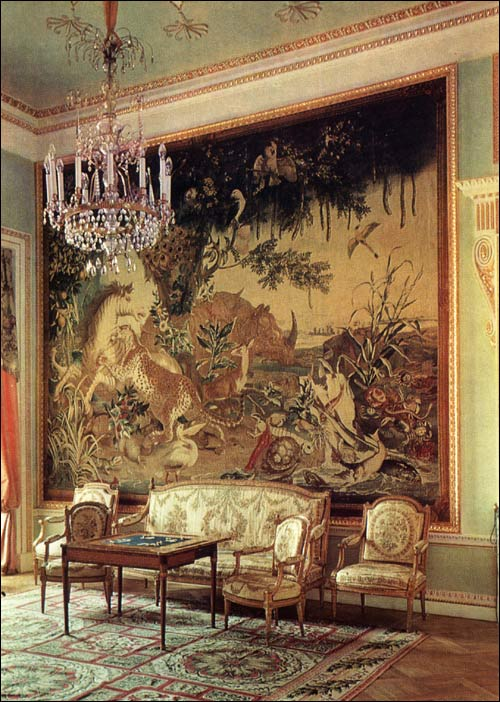The old drawing room includes an incredibly detailed custom Bessarabian rug that is as lively as the hung Gobelin tapestry from the cartoons of Alexandre-Francois Desportes.