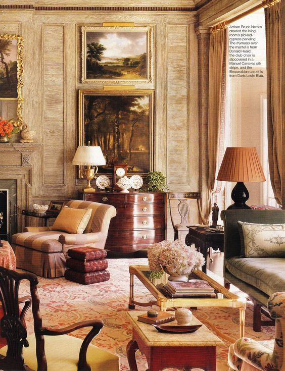 Richard Keith Langham uses pickled cypress wall paneling and a decorative Bessarabian rug in this Mississippi home, which had gone through major structural damage during a hurricane.