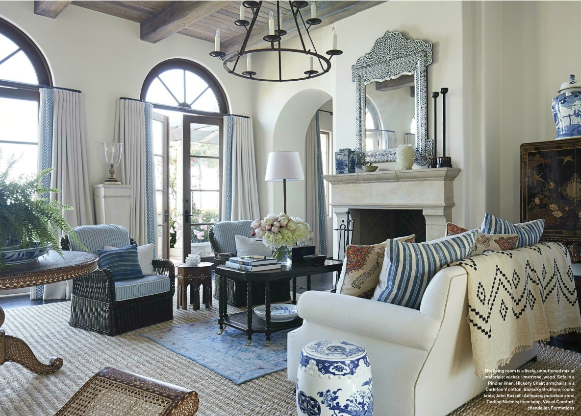 A blue oushak rug layered on an abaca rug in a living room designed by Mark D. Sikes - Veranda July/August 2016