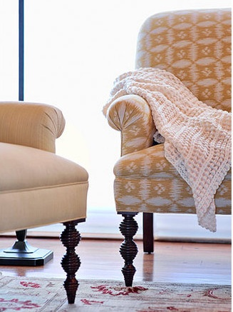 Asmara Designer Rugs Interview with Long Island interior designer Marlaina Teich - A gold and coral Oushak rug pops against yellow upholstery.