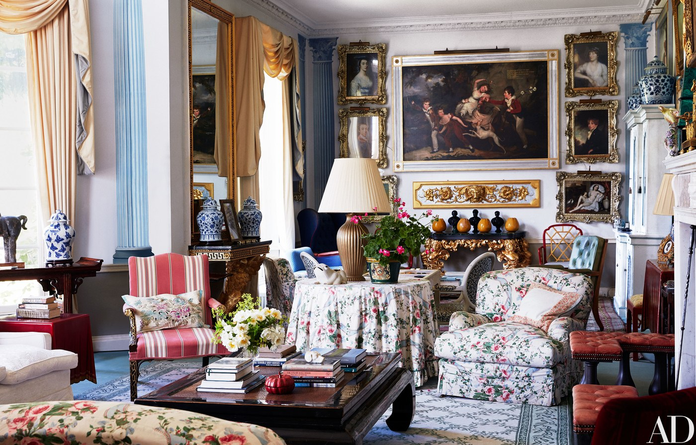 floral chintz is on display, but this time a sophisticated blue and white trellis rug is used