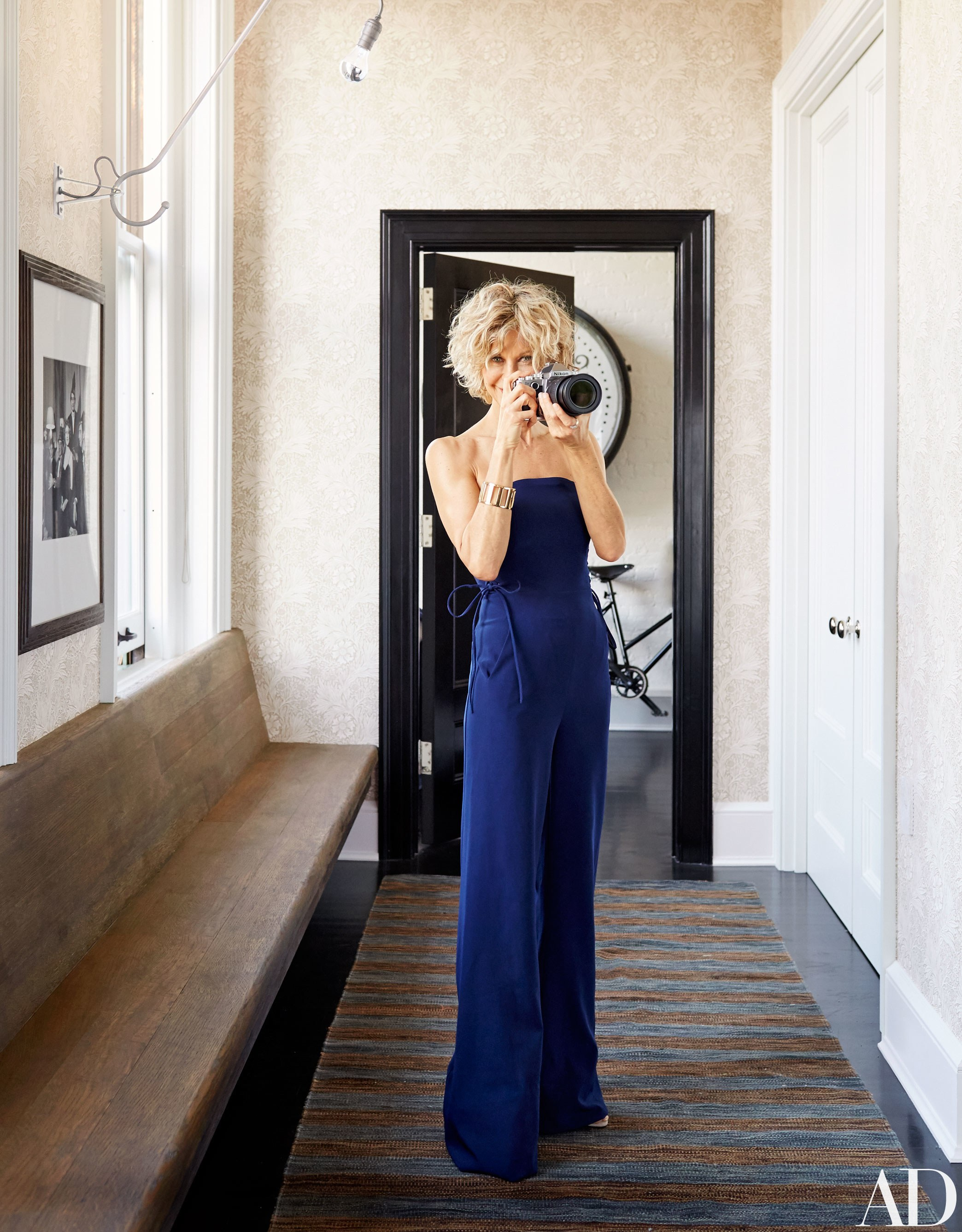 In the front hall of Meg Ryan's New York loft, you can see she selected a warm and cozy blue and brown striped flat weave rug.