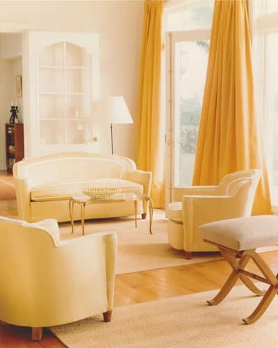 faded-gold-rug-muted-yellow-rug-living-room-stephen-sills-elle-decor.jpg