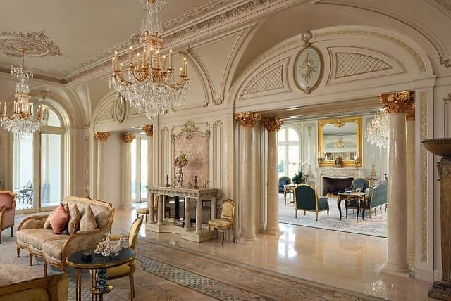 gold-and-blue-neoclassical-Savonnerie-rugs-in-adjoining-living-rooms-Le-Palais-Des-Anges-9577-Sunset-Boulevard- Beverly-Hills-California.jpg