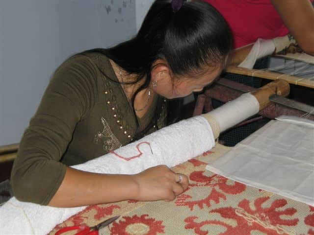 first-Bergamo-needlepoint-rug_sample-being_made-in-Asmara-Design-Workshop.jpg