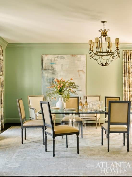 gray-oushak-rug-green-walls-yellow-chairs-lucite-table-dining-room-atlanta-homes-magazine-1.jpg