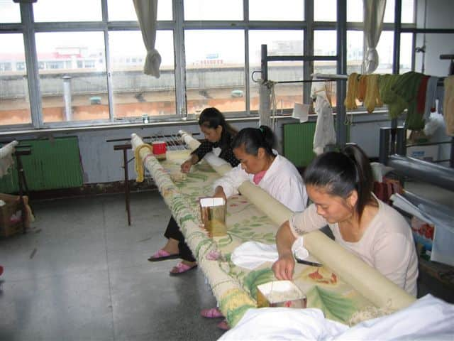 large-needlepoint-rug-being-made-by-hand-in-asmara-workshop.jpg