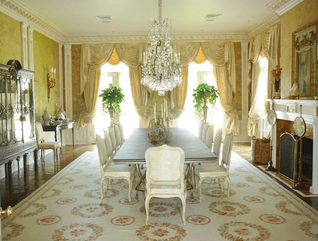 Arles-aubusson-rug-9402C-in-yellow-and-white-dining-room-with-Chinoiserie-wallcovering.png
