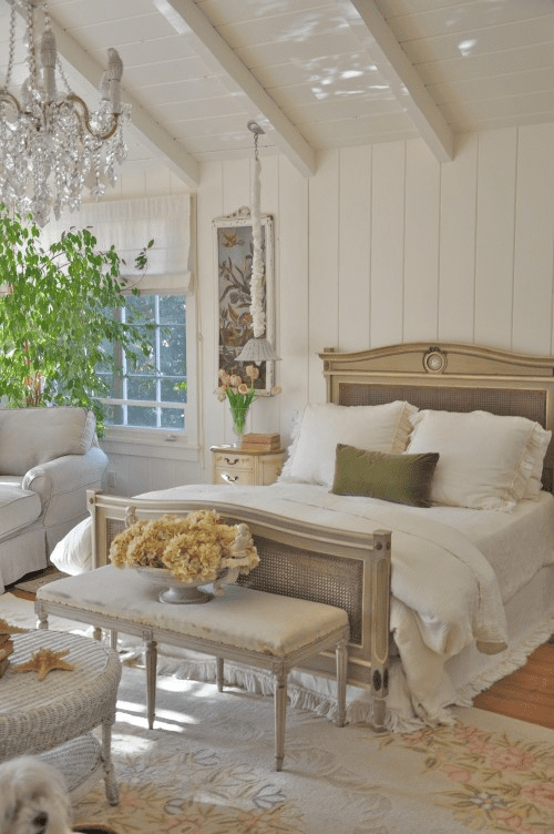 Floral Aubusson rug and white walls create a light and airy bedroom