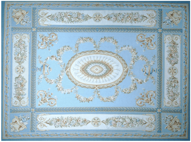 Margeaux Aubusson Rug 9428B has a Neoclassical design with a blue field, cream border and cream center medallion surrounded with Della Robbia garlands in rose, blue, green and gold and blue urns. The borders also feature Della Robbia flowers and shields