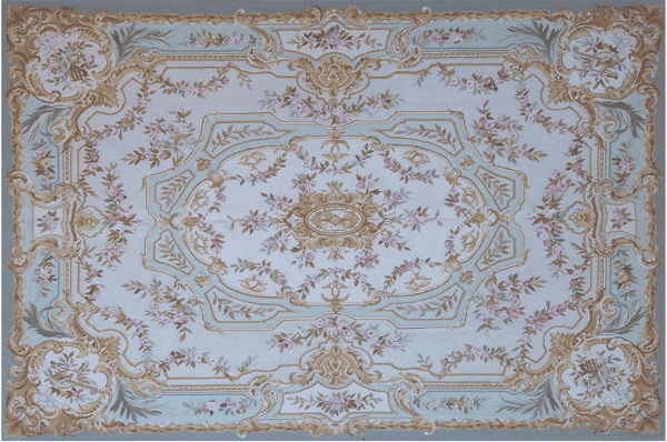 Dordogne Aubusson Rug 9418CG  has an aqua border, a pale lilac field a sea-green and pale lilac-gray outer medallion and corner cartouches and a gold inner medallion with floral wreaths and sprays in rose and green