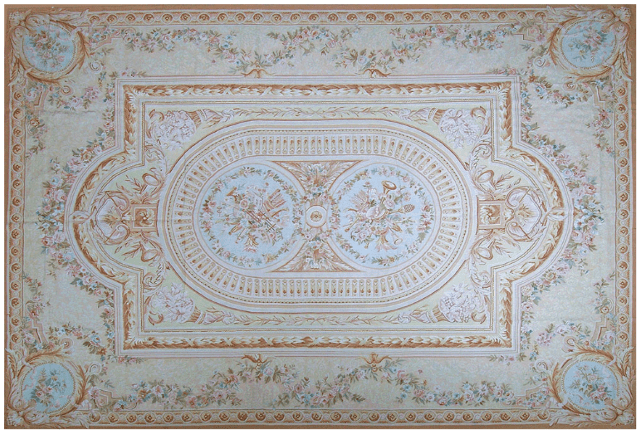Minerve Aubusson Rug 9429C has a cream and pale beige background with pale blue medallions with musical instruments and accents of rose, green, blue and yellow