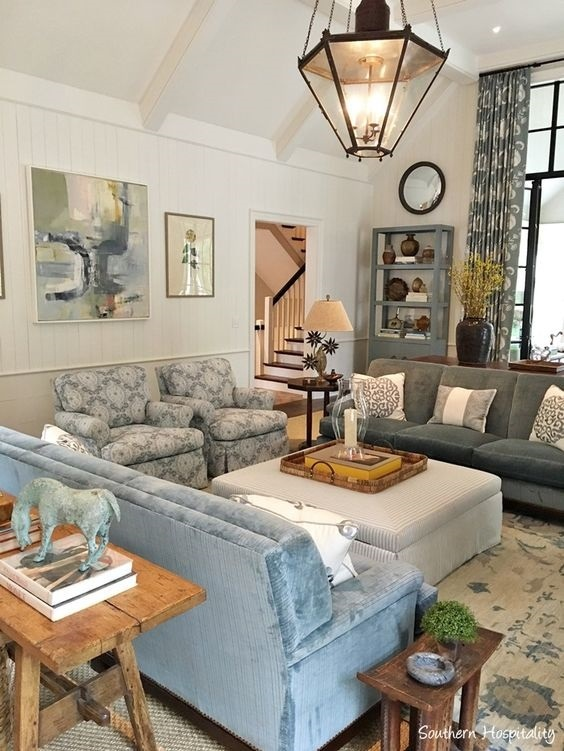 cream and blue oushak rug in family room designed by Phoebe Howard for the 2017 Southeastern Designer Showhouse