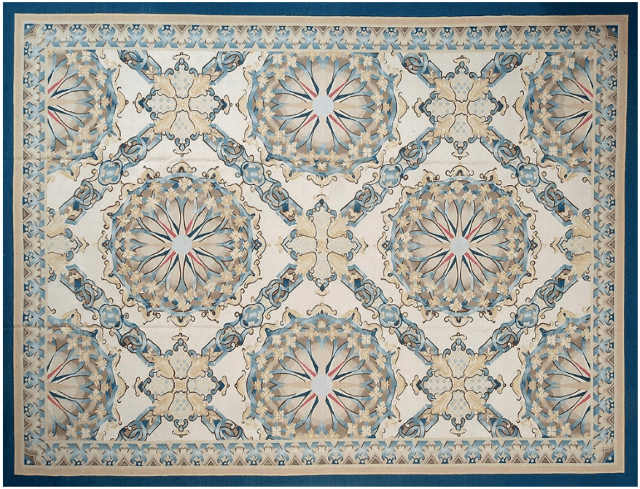 Aquitaine Aubusson Rug 9404CB has an architectural pattern of repeating blue and gold starburst medallions within a blue and gold trellis
