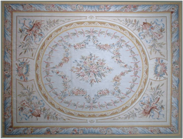 Avignon Aubusson Rug 9407C has beige field with musical instruments and a large cream oval medallion with blue, green, rose and gold floral garlands all surrounded by a blue acanthus leaf border