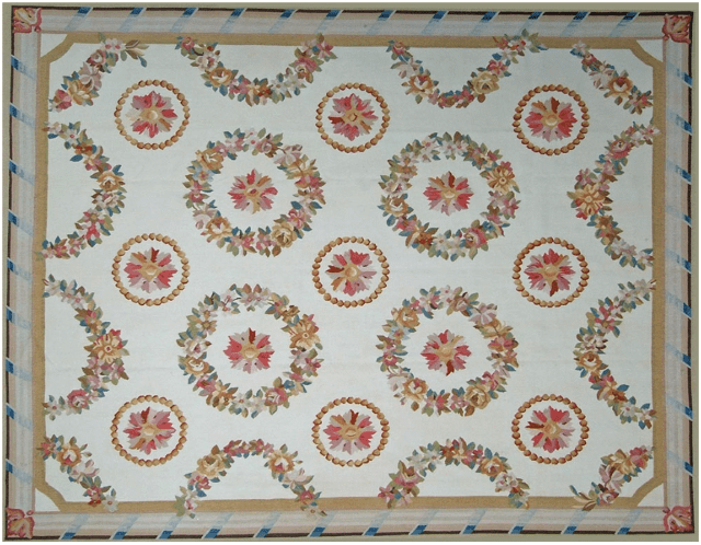 Arles Aubusson Rug 9402C has gold, green, aqua and red floral wreaths and red, gold and taupe stars diapered across a cream field surrounded by a cream, gold and blue band border