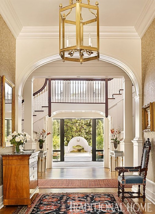 foyer rug is a navy oriental rug in traditional foyer designed by Carolyn Griffith