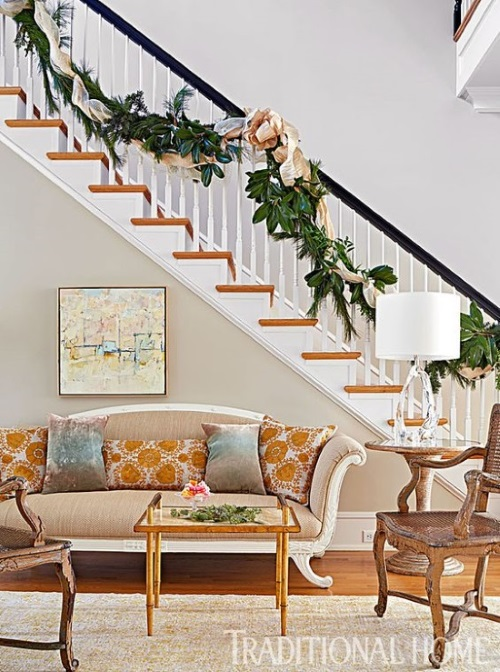 Foyer rug is a gold oushak rug in traditional entryway with Duncan Phyfe sofa