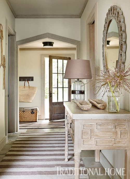 Foyer rug is a gray striped rug  in traditional entryway designed by Beth Webb